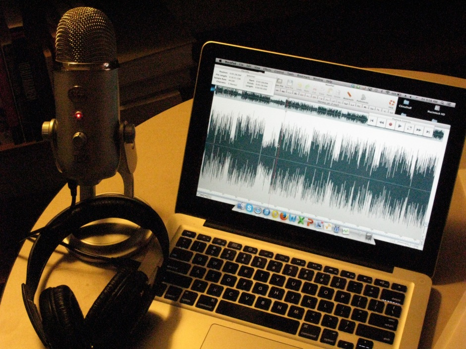 A computer, a microphone, and earphones: all you need to record a podcast.