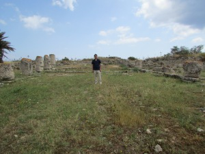 Young Kim standing in the ruins of the Basilica of Epiphanius, in the occupied area.