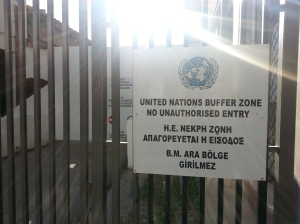 "Sign reading ""United Nations Buffer Zone. No Unauthorized Entry"" in English and Greek."