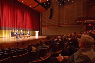 Panelists on stage showing audience.