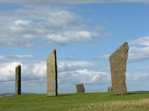 massive stones standing on a stretch of green grass