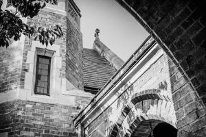 black and white image of a church archway