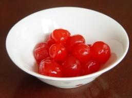 bow of bright red maraschino cherries
