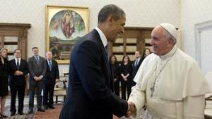 President Obama shaking hands with Pope Francis at the Vatican