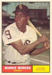 Baseball card featuring African American player holding a bat
