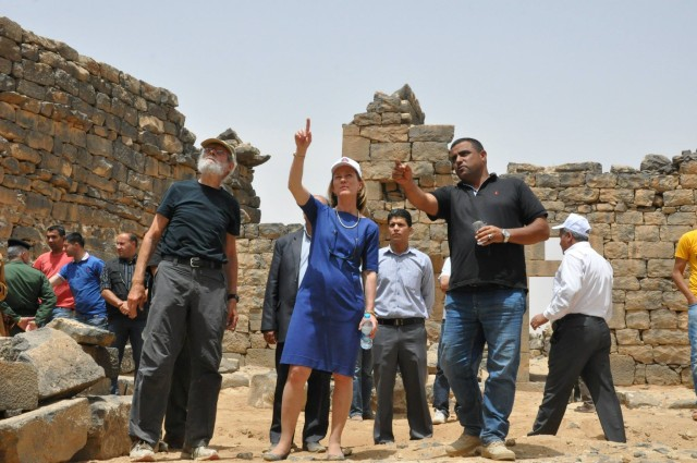 Umm el Jimal workers greet the ambassador and other visitors at the site