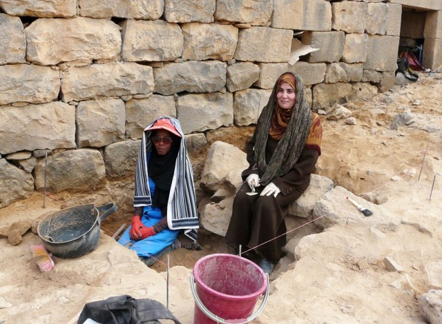 Two women working on an excavation.