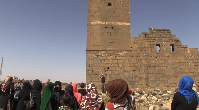 Group of women at archaeological site.