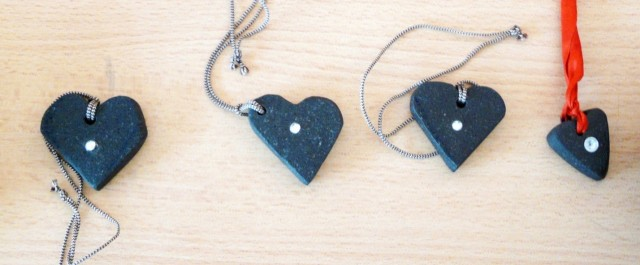 Handcrafted basalt heart-shaped jewelry.