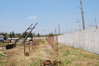 barbed wire and high wooden fences