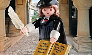 toy Martin Luther holding a scroll