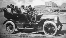 A group of Native people in a car from the Eskimo Automobile Transfer Company heading toward Cape Prince of Wales and Kotzebue Sound, Alaska, 1905.