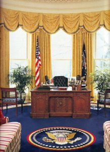 Ornate carved desk in the Oval Office.