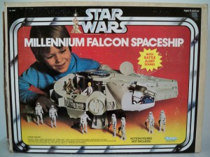 Box from the 1978 Kenner Millennium falcon showing a kid playing with a spaceship and action figures.