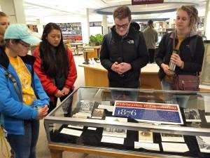 Students examine the exhibit they created.