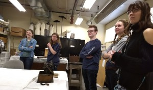 Students in a museum storage room.
