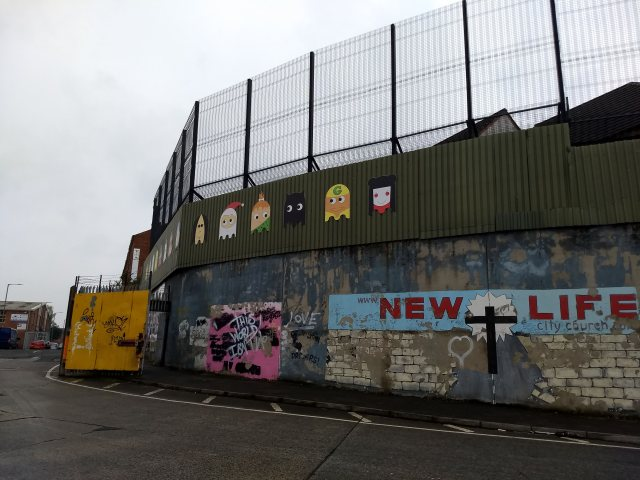 Peace Wall in Belfast with graffiti and art.